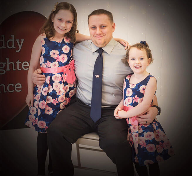 Nick Bordenski with his two daughters
